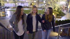 Teens Walk Up Stairs At An Outdoor Mall Decorated For Holidays, They Laugh Stock Footage