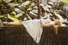 Sleeping Beauty Fairytale Princess Laying on Rock Bed Stock Photos