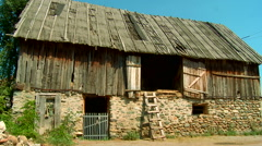 Old barn for animals and hay on the village Stock Footage