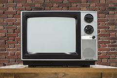 Analog Television with Brick Wall - stock photo
