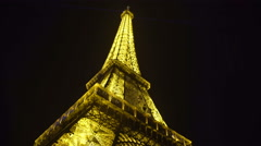 Grand iron construction of Eiffel Tower sparkling with lights in night Paris Stock Footage