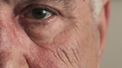 Detail of serious old man's eye Stock Footage