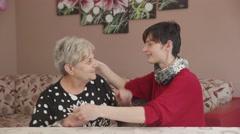 Big hug between grandmother and her grand-daughter Stock Footage