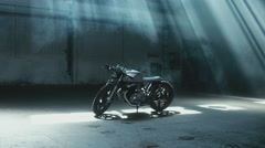 Wide dolly shot of a custom cafe racer motorcycle standing in the garage Stock Footage