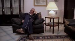Worried, anxious man sit on armchair in his living room Stock Footage