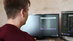 Man programmer working on a program code Stock Footage