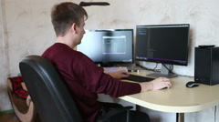 A man working at a computer programmer. Testing the program code Stock Footage