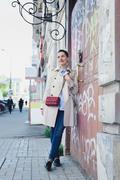 Biz lady after working concept, elegant woman in a beige coat Kuvituskuvat