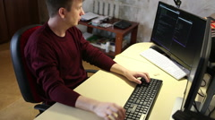 Programmer working on the computer. Edit program code - stock footage