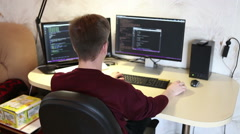 Programmer working on the computer. Edit program code Stock Footage