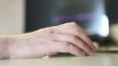 Young programmer to scroll programming code. Computer mouse in hand closeup Stock Footage