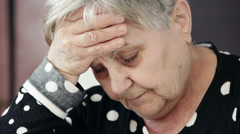 Ill old lady with strong headache Stock Footage