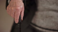Old man's hand shaking while holding the stick Stock Footage