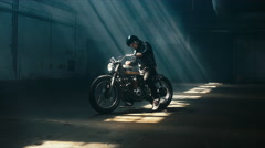 Young Caucasian male biker in riding his custom cafe racer motorcycle Stock Footage