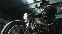 Close up shot of Caucasian male biker riding his custom cafe racer motorcycle Stock Footage