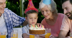 A little boy looking his birthday cake Stock Footage