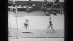 1968: Věra Čáslavská Czechoslovakia women's gymnastics uneven bars Summer - stock footage