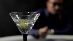 Martini glass with an olive close-up - stock footage