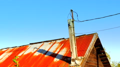 4K Close Up, Rusty Tin Corrugated Metal Roof, Blue Sky Stock Footage