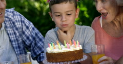 A little boy blowing out the candles Stock Footage