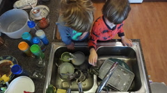 Little Boys Washing Dishes In Kitchen Stock Footage