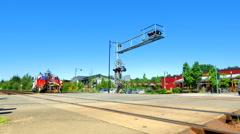 4K Crossing at Railroad Crossing, Signal Signs at Train Tracks Stock Footage