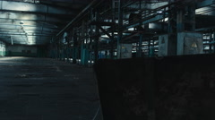 Right to left dolly wide angle shot of abandoned factory interior Stock Footage