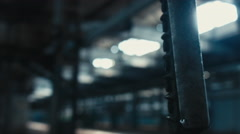 Close up shot of a swinging remote controller on abandoned factory Stock Footage