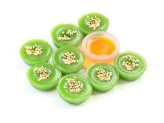 Green multiple scented sesame chinese sweet around liquid sugar on white floo Stock Photos