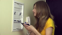DIY girl solved which fuse has blown on electical fuse board Stock Footage