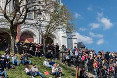 PARIS, FRANCE - MAY 1 2016 - Montmartre stair is crowded of french people tor - stock photo