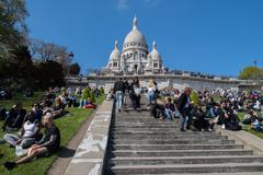 PARIS, FRANCE - MAY 1 2016 - Montmartre stair is crowded of french people tor Stock Photos