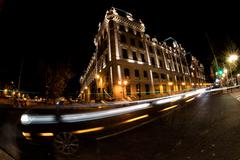 car light tracks at Paris at night in front of barracks justice palace near n - stock photo