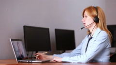 Female customer support operator. she leads online consultation using web camera Stock Footage