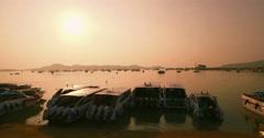 Sunrise Over Speedboats Moored On Beach Slider Aerial Shot Stock Footage