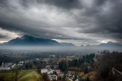 Salzburg castle view landscape panorama in winter cloudy day - stock photo