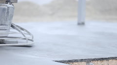 Worker smoothes concrete surface Stock Footage