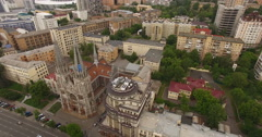Ancient gothic Catholic church and business center on the city street Stock Footage