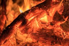 red hot wood embers detail in fire place - stock photo