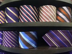 different colors silk tie on display stand - stock photo