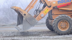 bulldozer spreads gravel on the territory - stock footage