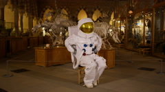 4K Funny spaceman exhibit in science museum comes to life & goes off for a break - stock footage
