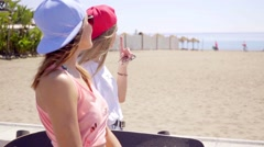 Carefree friends near beach with wind blown hair Stock Footage