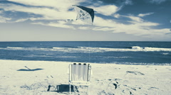 Chaise lounge on the beach, the sea and a kite. Stock Footage
