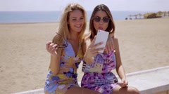 Mischievous young ladies taking a selfie Stock Footage