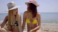 Two young women enjoying a day at the beach Stock Footage