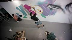 Artists doing graffiti on wall. Stock Footage
