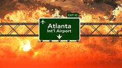 Passing under Atlanta USA Airport Highway Sign in a Beautiful Cloudy Sunset Piirros