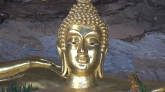 Wat Tham Khuha Sawan A golden Buddha statue Stock Footage