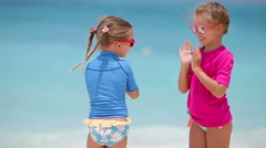 Adorable little girls at beach during summer vacation - stock footage
